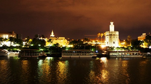 View of the Torre del Oro in Seville from Triana At Night