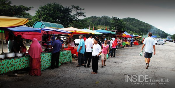 Foreign Man walking along the road - crowded Malaysian street food