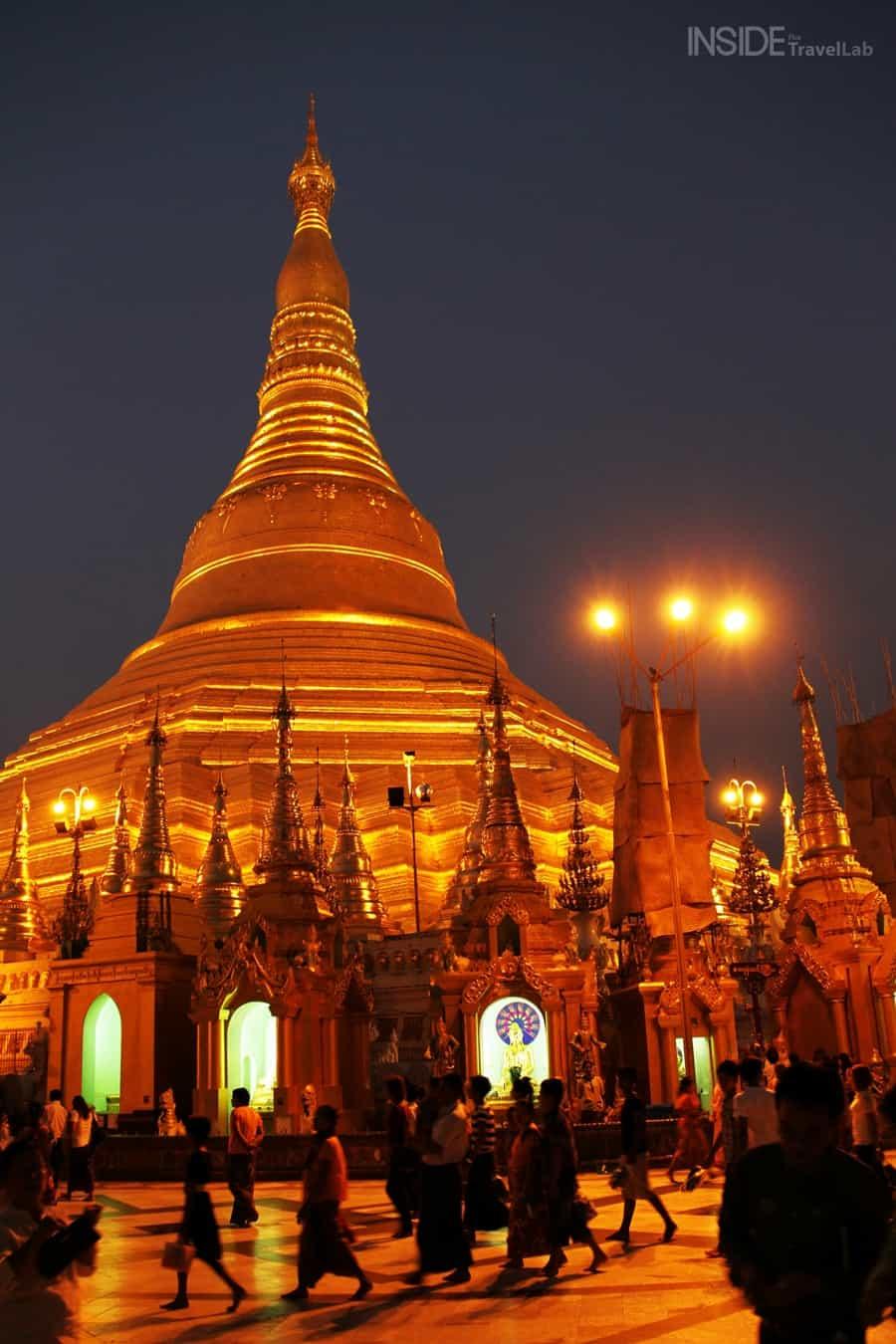 Shwedagon Pagoda with people at night