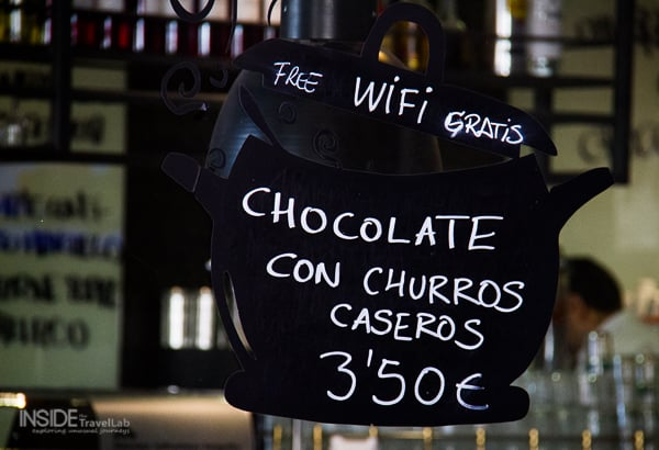 Churros and chocolate advert in Madrid cafe window