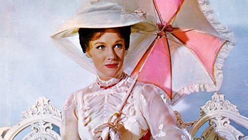 Mary Poppins holding a pink and white umbrella