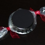 bottle cap candy with magnet attached