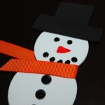 attach orange grosgrain ribbon as scarf