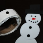 add 7mm black rhinestones to snowman magnet
