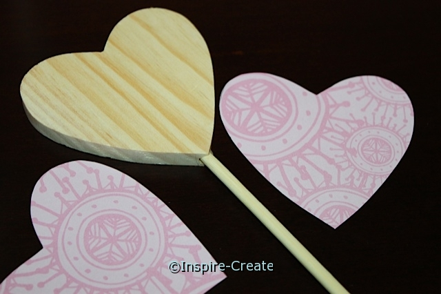 cut hearts out of paper for wand
