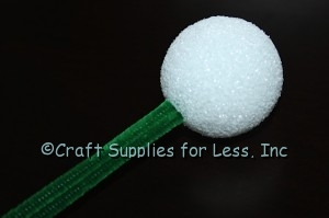 Green chenille stems added to styrofoam ball