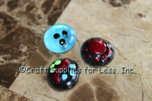 small glass gems with designs painted on top