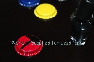 Paint black stripe down center of bottle cap