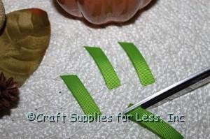 "cut green grosgrain ribbon into 1 1/2"" pieces"