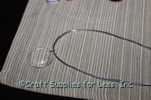 clear glass gem with elastic cord