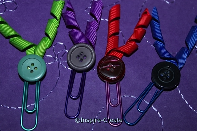 add curly ribbon to paperclips for bookmarks