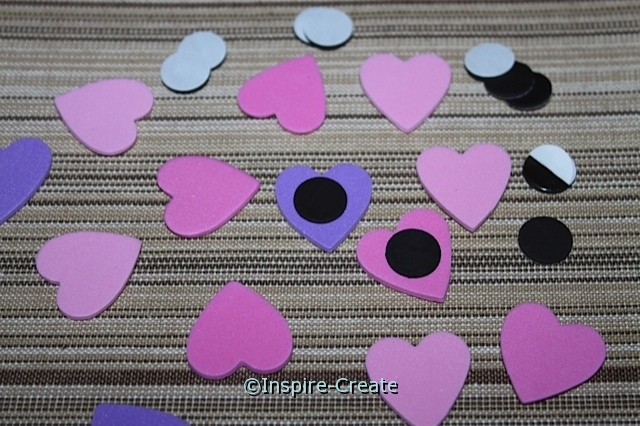attach adhesive craft magnets to heart shapes