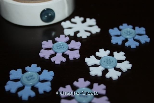 add buttons to snowflakes with glue dots