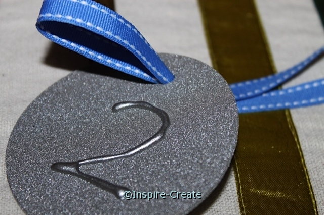 add saddle stitch ribbon to medals