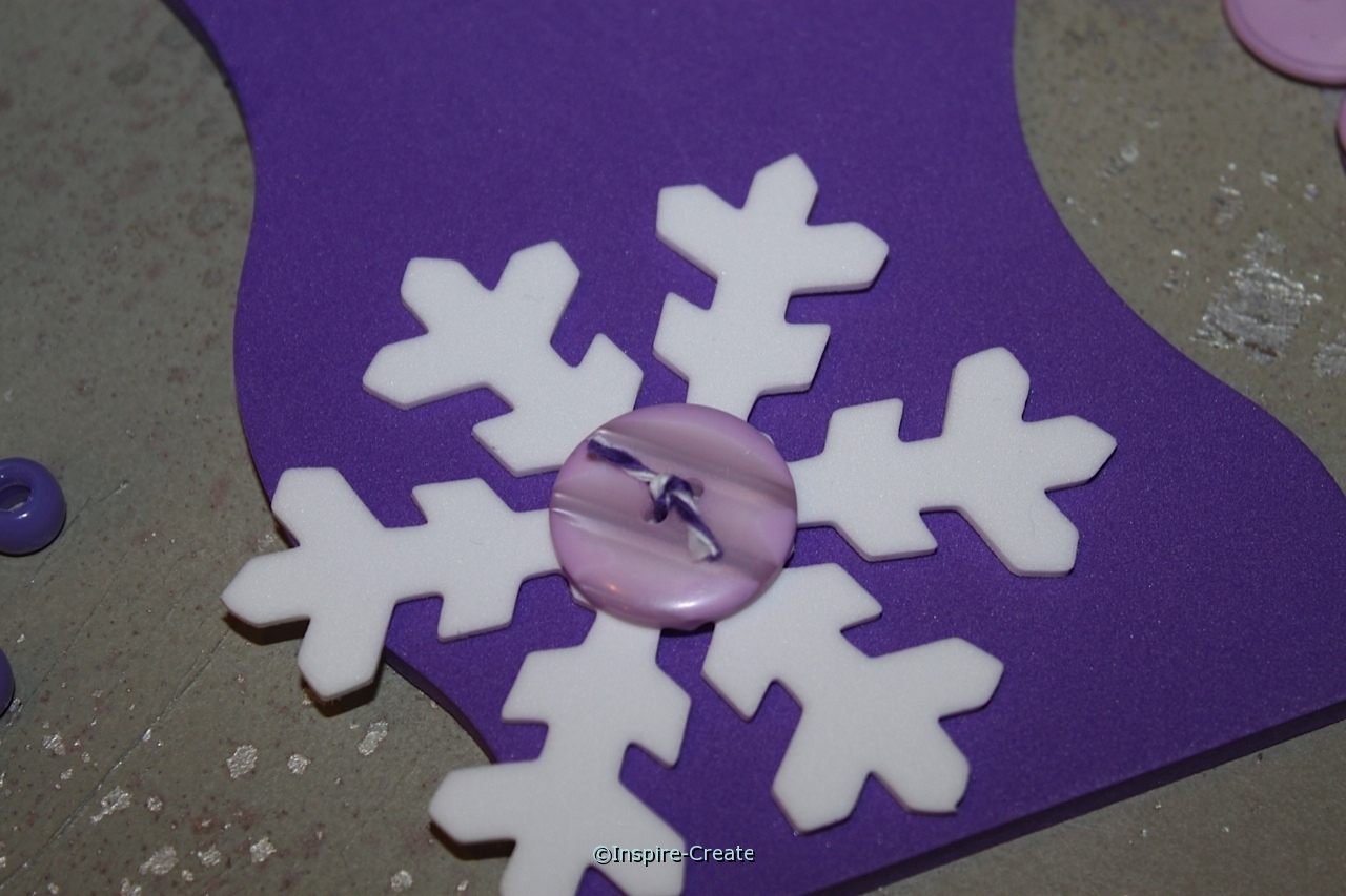 attach large snowflakes to door hanger