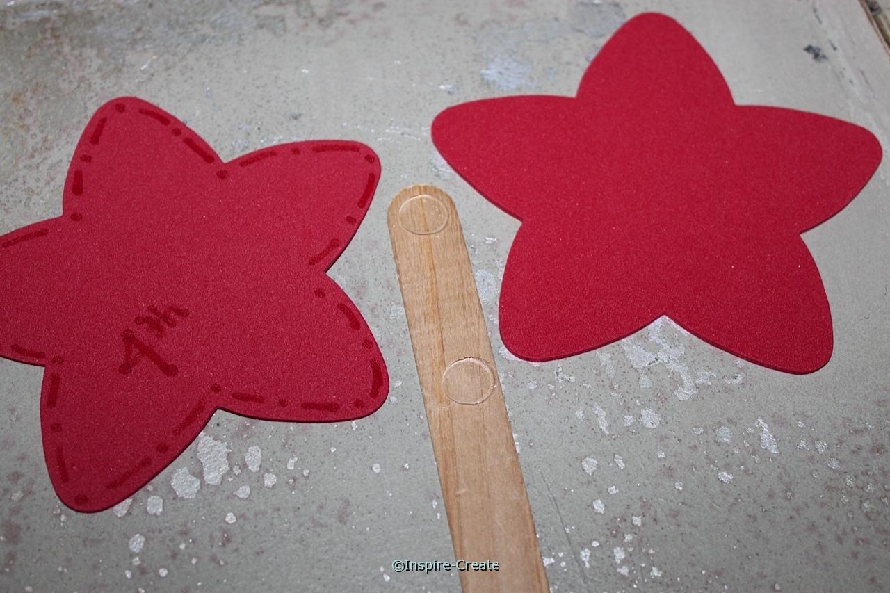 add craft foam stars to jumbo craft sticks with Glue Dots