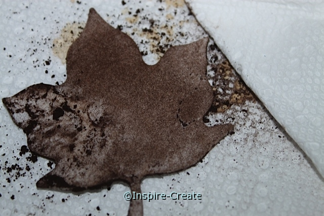 Rub craft foam leaf to remove excess coffee grounds