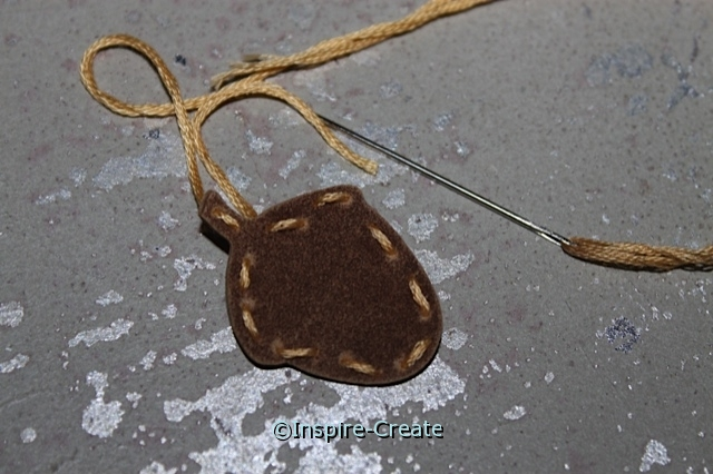 "Add ""stitches"" to craft foam with embroidery floss"