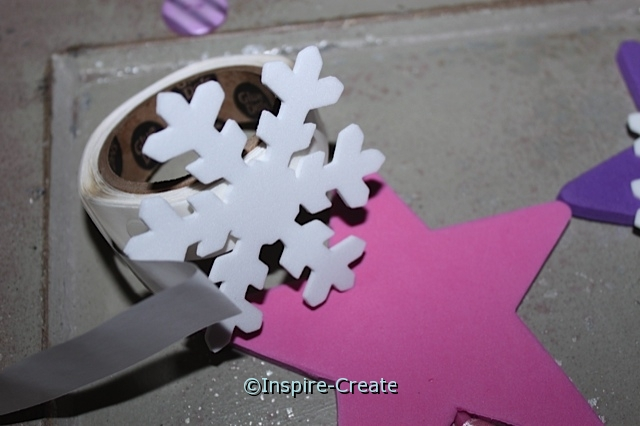 Attach snowflake shape with glue dots for a no mess craft!