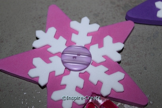 Add a button to the center of the snowflake wand!