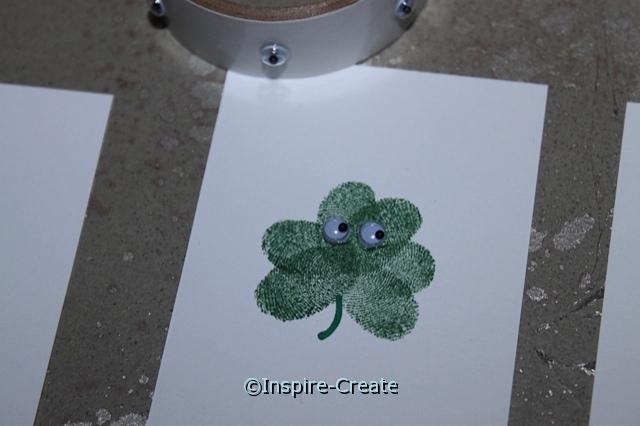 Add wiggle eyes to fingerprint shamrocks!