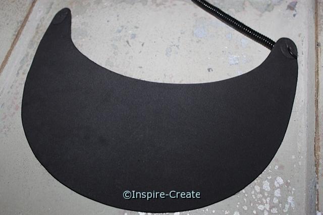Remove vinyl coil from black visor to flatten.