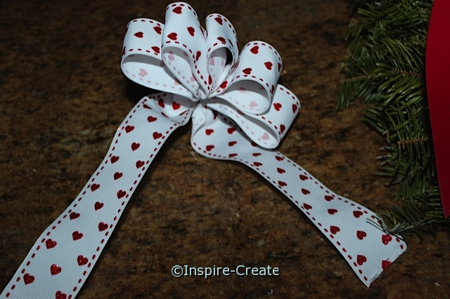 Make a red glitter heart bow for Valentine's Day Wreath.