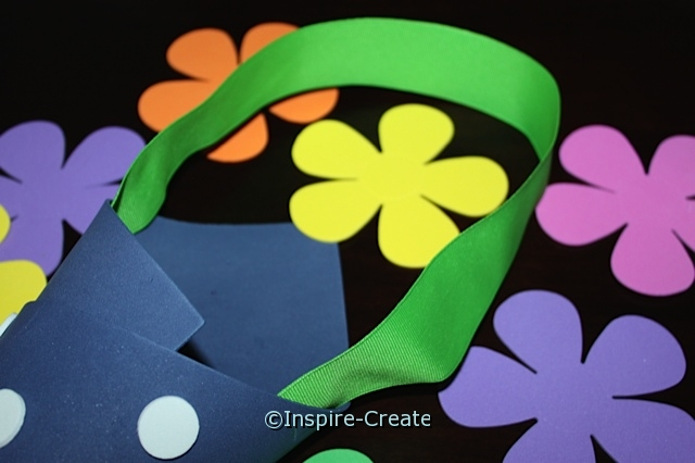 Flowers for May Day... Make the door hanger by stapling ribbon to the craft foam vase. Then it's ready to hang!