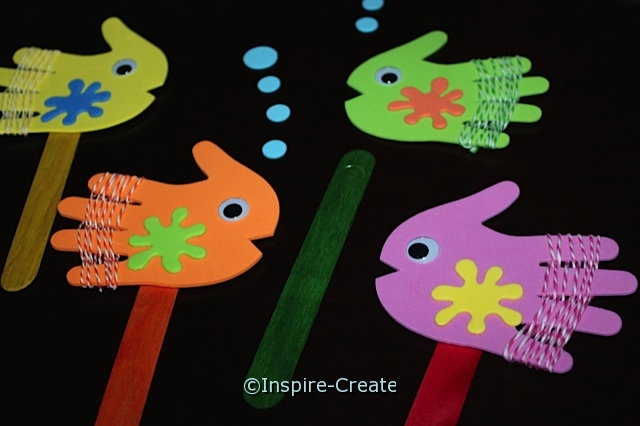Fish Stick Puppets with hand shapes and jumbo craft sticks.