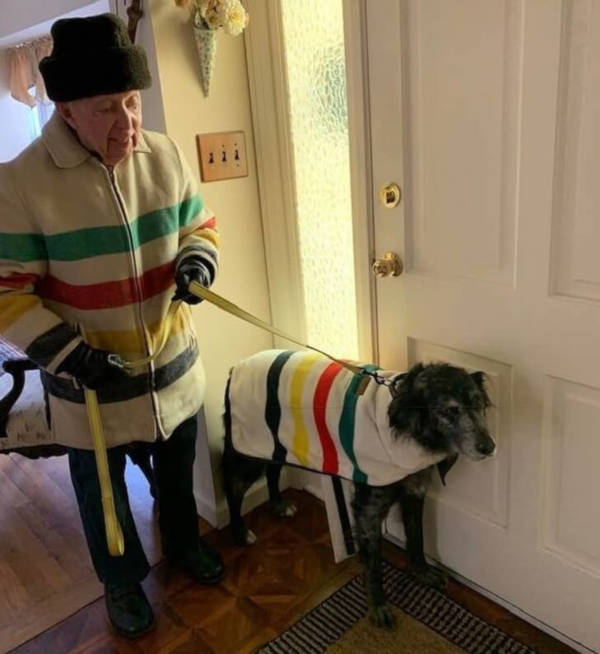16. This grandfather and his grandfather dog braving the winter chill together in matching outfits.