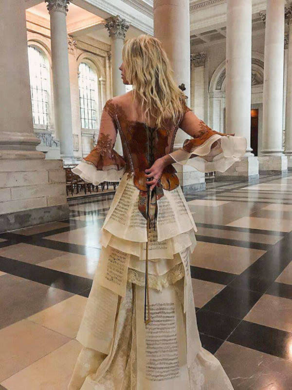 French Designer Creates Unique Dresses From The Spines of Books - 9