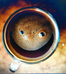 Macro shot of coffee cup with smiley