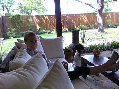 Me, working away.  In order to find quiet, I've been working on the patio, kitchen table, bedroom.