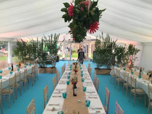 21st birthday party with a fantastic turquoise carpet in a framed marquee.  Long tables with hessian runners.  Dahlias from the garden!