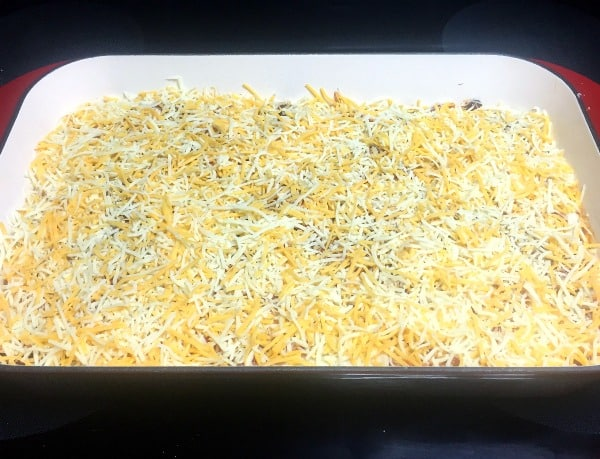 All layers complete and chicken enchilada casserole ready to bake in the oven