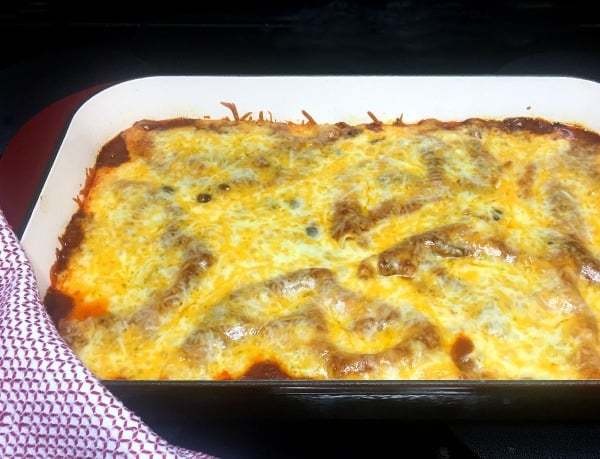 Chicken enchilada in baking dish just out of the oven