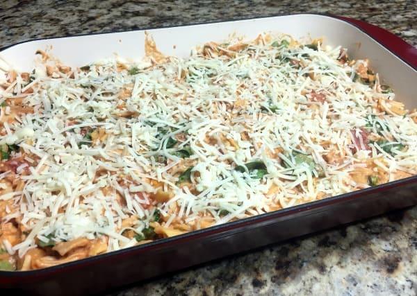 Butternut squash pasta bake in a casserole dish ready to bake