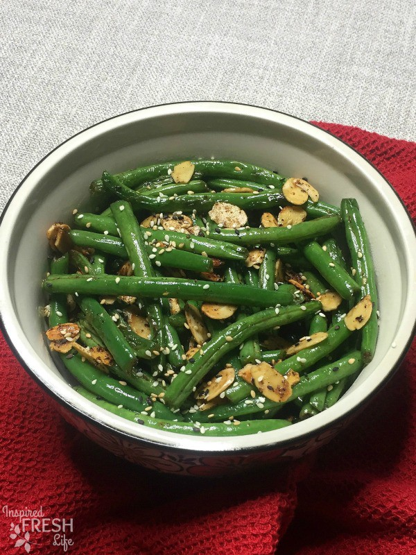 Toasted Sesame Green Beans garnished with sesame seeds in a serving bowl, top view