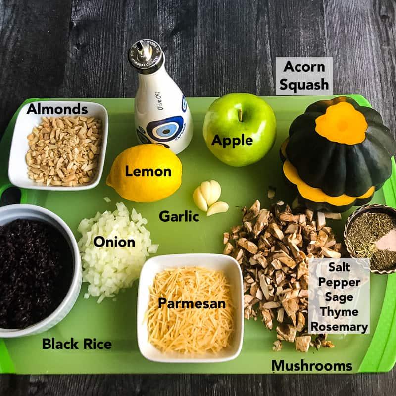 Ingredients for Vegetarian Stuffed Acorn Squash on a green cutting board.