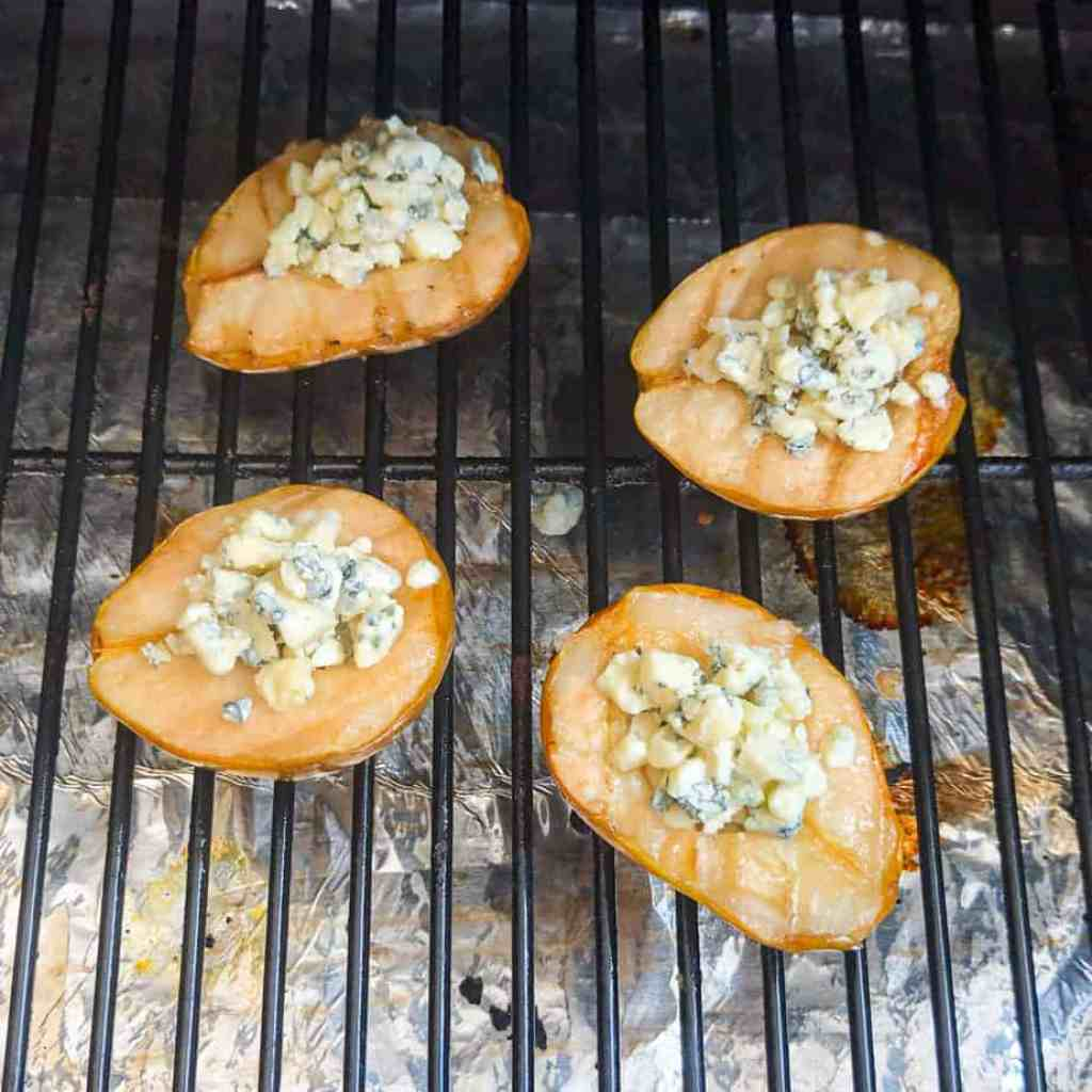Pears turned over on the grill and stuffed with gorgonzola cheese.