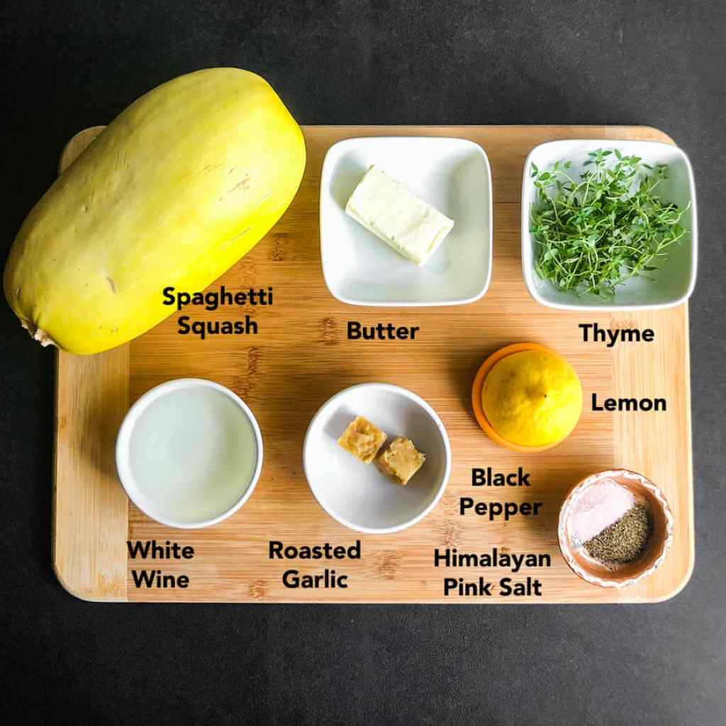 Ingredients for Oven Roasted Spaghetti Squash on a wood cutting board.