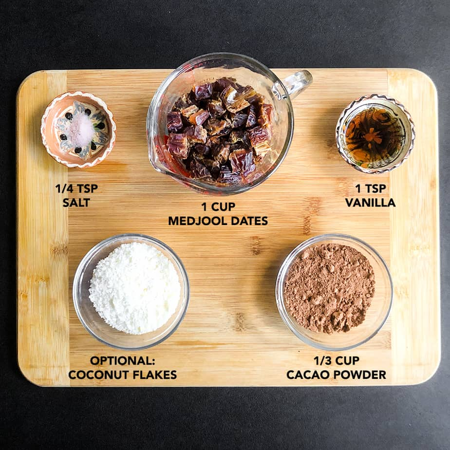 Ingredients portioned in small bowls on a wood cutting board.