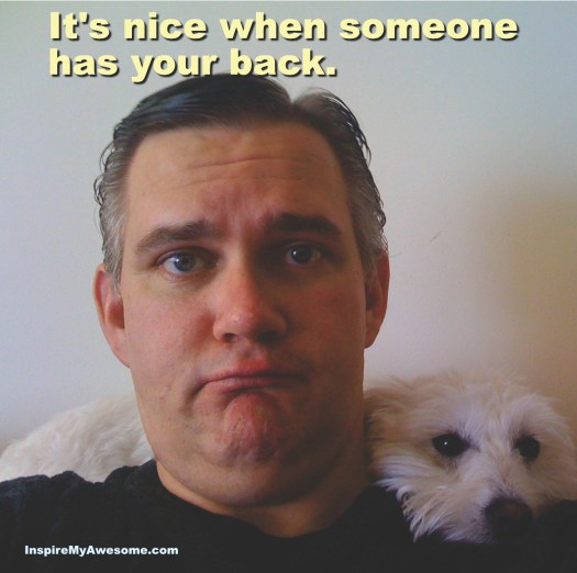"Picture of a dog around a man's neck with the comment ""It's nice when someone has your back."""