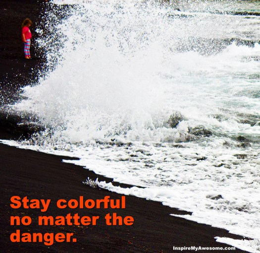 "Picture of a girl in bright clothing near crashing waves, with the phrase ""Stay colorful no matter the danger."""