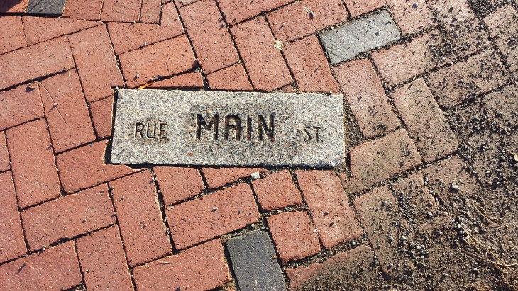 Street name enveloped in the footpath Moncton Canada.
