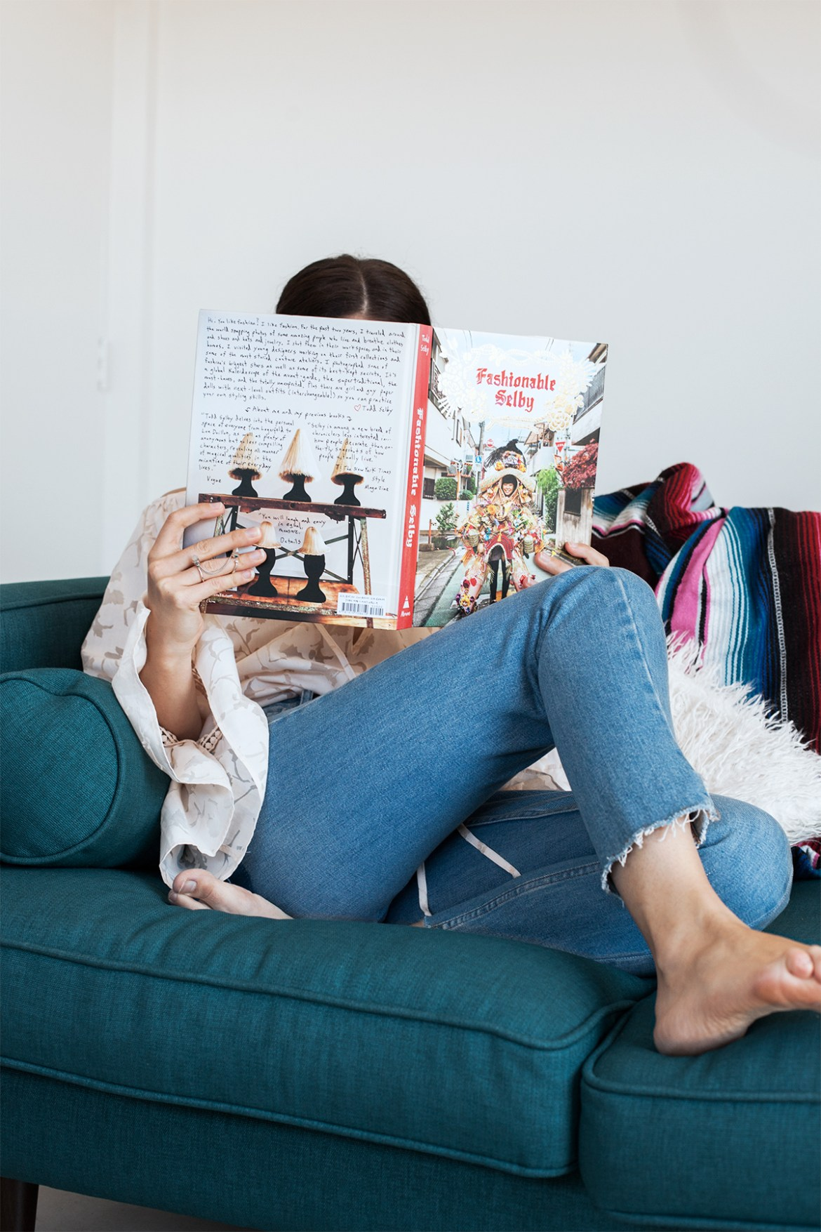 Inspiring Wit Australian fashion blogger at home in Stevie May blouse reading The Fashionable Selby