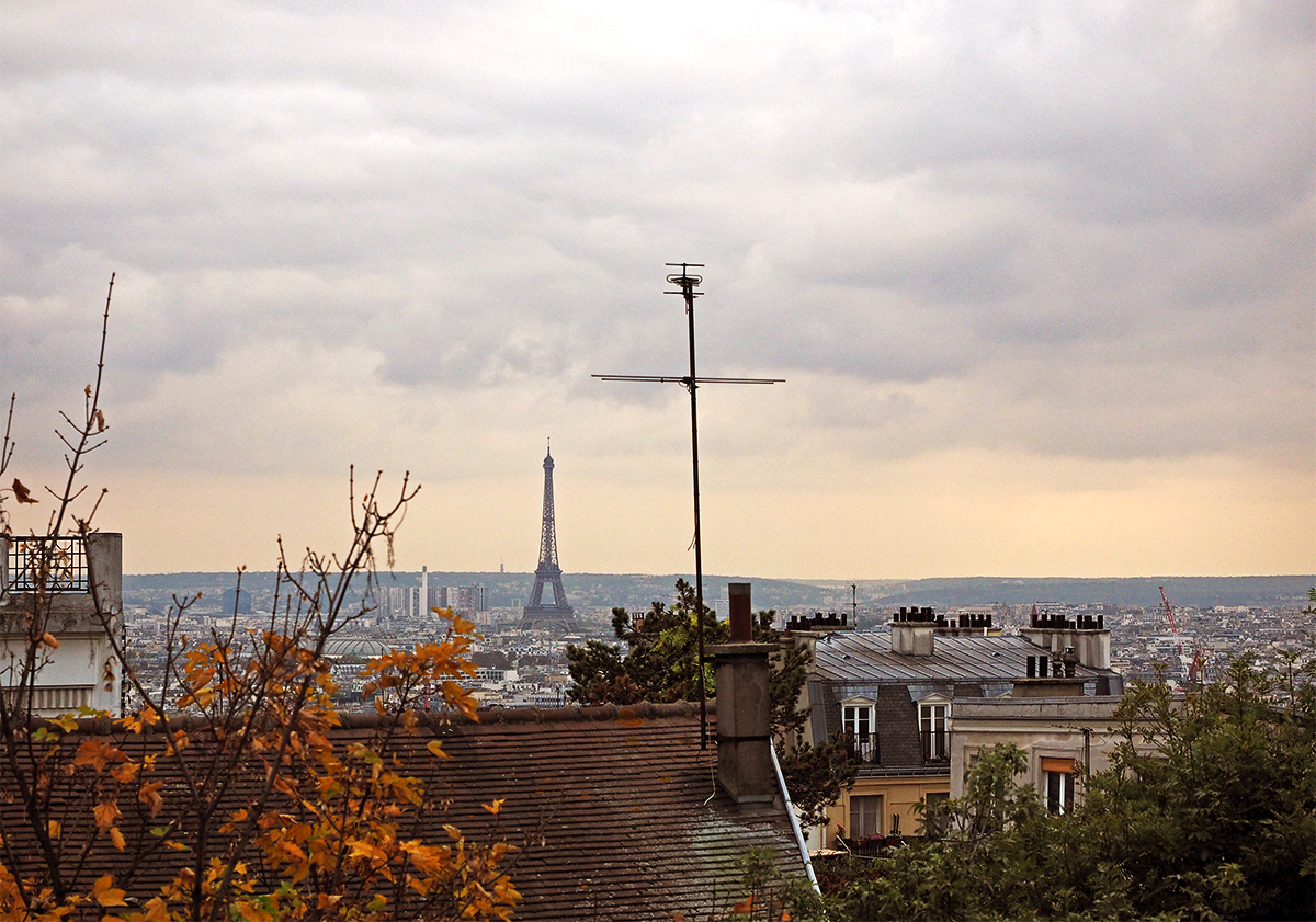 Eiffel Tower view from Montmartre over rooftops of Paris, travel blogger Inspiring Wit
