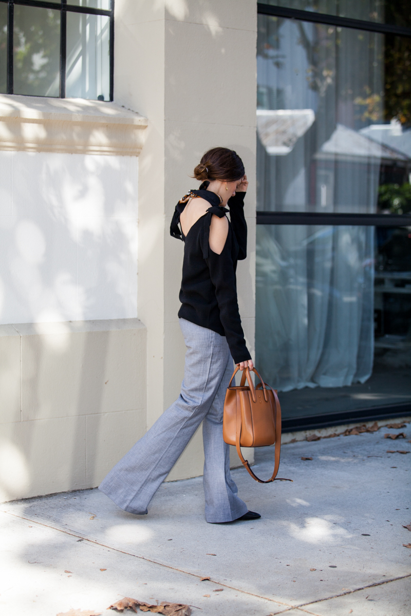 Autumn look for the office, Jenelle of Inspiring Wit blog, grey flares, tan X. Nihilo bag and MVN knit top