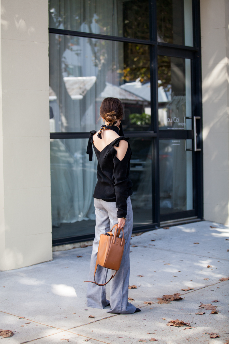 Autumn office style, Jenelle of Inspiring Wit blog, grey flares, tan X. Nihilo bag and MVN knit top