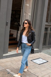 By The Weekend striped blue camisole worn by Jenelle from fashion blog Inspiring Wit with black leather moto jacket, Manebi espadrilles and mom jeans